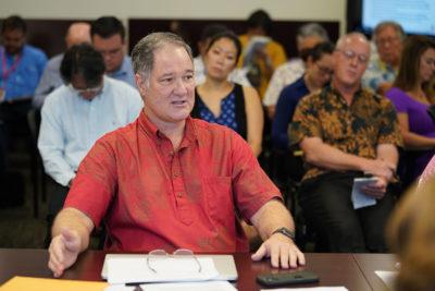 Council on Revenues Member Carl Bonham asks State Economist Eugene Tian about his presentation.