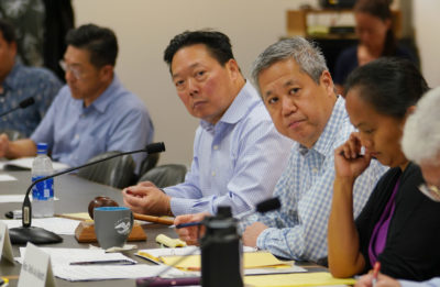 Chair of the Coronavirus Committee Speaker Scott Saiki and left, CEO Bank of Hawaii Peter Ho during committee hearing at the Capitol.