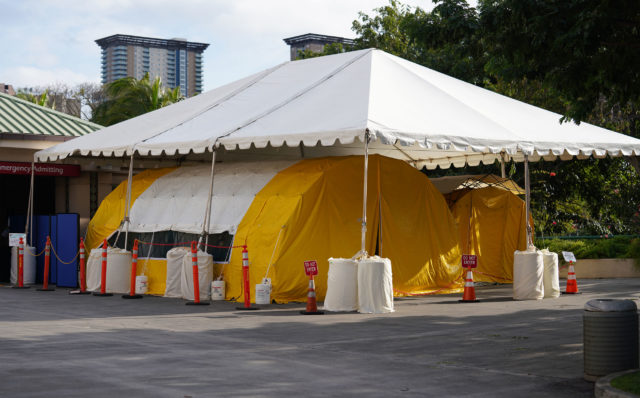 Queen' s Hospital tents outside the Emergency Room area.