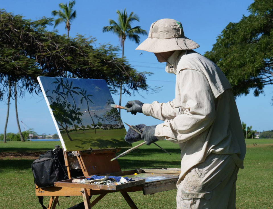 Painter David Luchak, works on a landscape oil painting at Neal S. Blaisdell Park in Aiea, Sat March 14, 2020. Luchak was part of a group of artists gathering at the park to paint together for the day. (Ronen Zilberman photo Civil Beat)