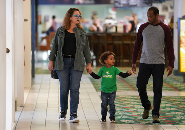 Andrea Grabow walks with her husband, Pancho Macias Tenorio and their son, Francisco Macias Grabow at Kahala Mall.