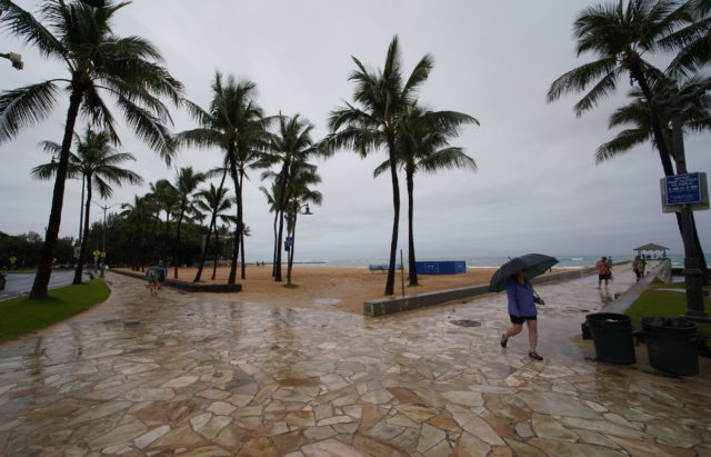Kapahulu Groin Walls with very little foot traffic on the sidewalks and the beach was empty.