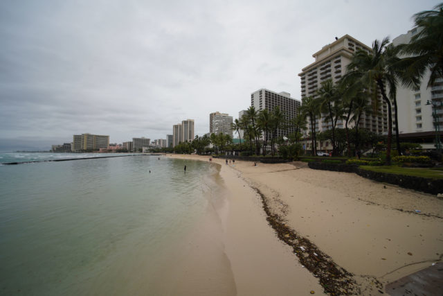 Very people were enjoying the beach on a rainy day in Waikiki.