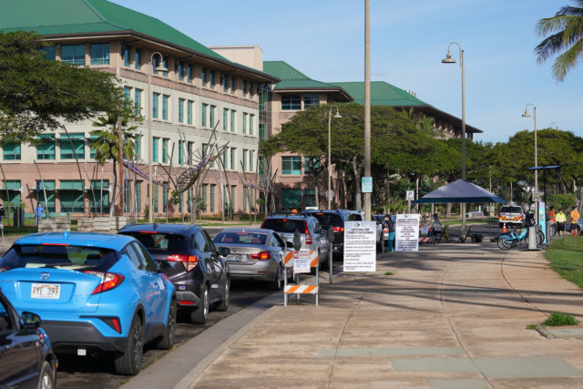 Scores of cars lineup going into the mauka entrance of Kakaako Waterfront park for Coronavirus testing.