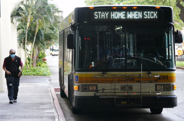 TheBus at Ala Moana Center. Sign reads, 'Stay home when sick' due to Coronavirus concerns. March 2020.