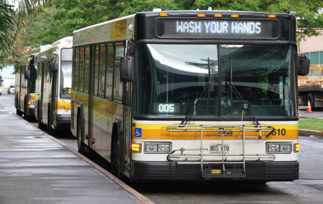 TheBus Buses lined up at Ala Moana with signs 'Wash your hands' due to Coronavirus concerns.