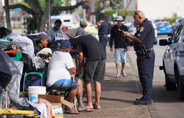 HPD citing homeless along Beretania Street, officer claimed they were blocking the sidewalk.
