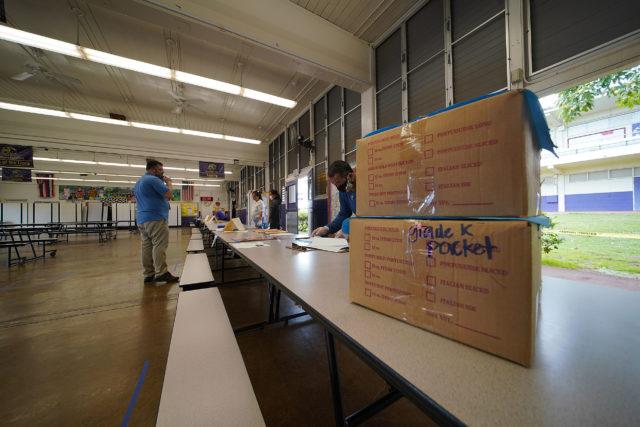 Kalihi Waena Elementary School packet pickup at their cafeteria. Coronavirus