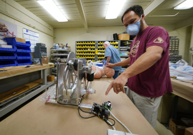 Olin Lagon points to the Ventilator's intervalometer portion of the machine while at Bear Machinery in Kaneohe.