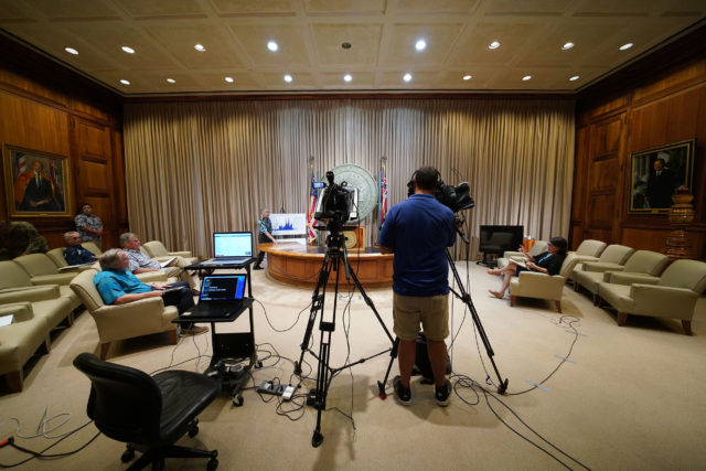 Governor David Ige walks up to podium at the Capitol during an update on 3 dead from Coronavirus COVID19. April 3, 2020.