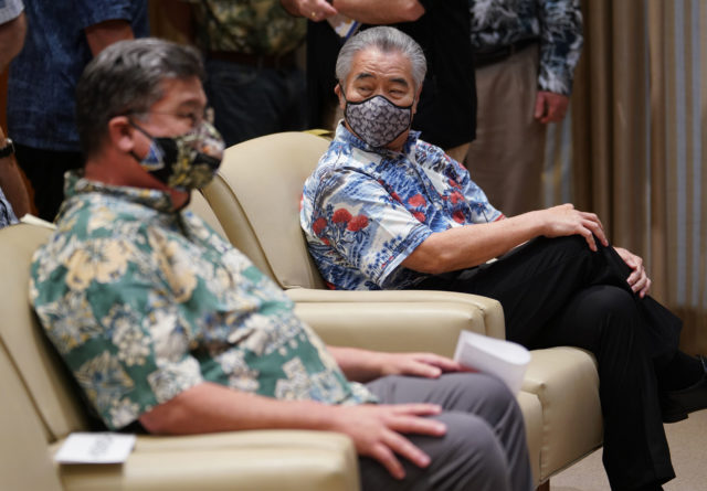Governor David Ige wears a Coronavirus Mask with Senate President Ron Kouchi at the Capitol. April 8, 2020.