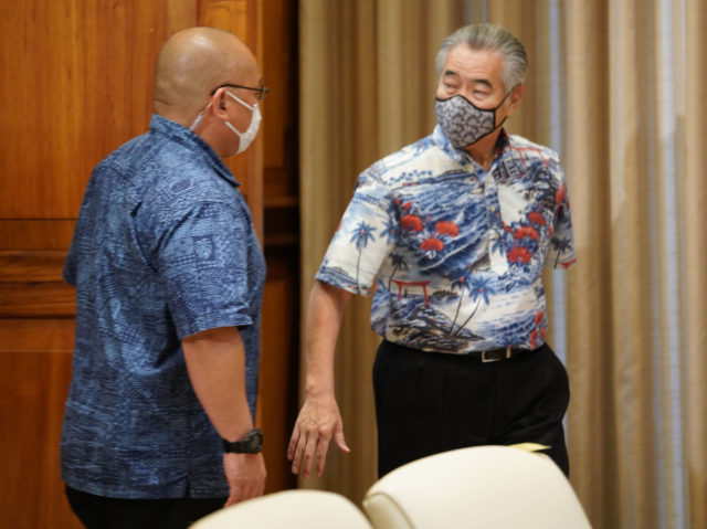 Governor David Ige enters ceremonial room wih mask on before Coronavirus COVID-19 press conference. April 8, 2020.