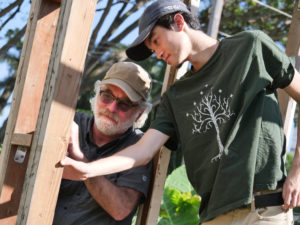 John (left) and his son Kai work together to build a tool shed as part of a project for Kai's Eagle Scouts program, at the Makiki Park Community Garden, on Thursday, April 9, 2020 in Honolulu, HI. (Ronen Zilberman photo Civil Beat)