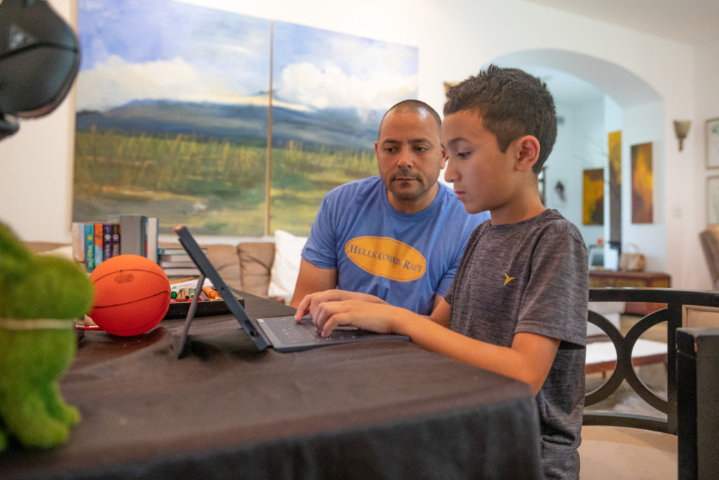Brendan Punu, 5th grader at Punahou School, remote learning with his family in Makawao, Maui during the 2020 COVID-19 pandemic. Father Brand Punu