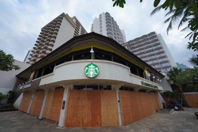 Waikiki Starbucks Coffee near the Kapahulu Avenue is is boarded up during Coronavirus COVID-19 pandemic. April 15, 2020.