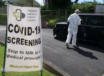 A volunteer from the the COVID Command Mobile Unit, of the Premier Medical Group Hawaii, screens people as they show up for the free drive through testing event in Wahiwa,HI on Wednesday, April 22, 2020. (Ronen Zilberman photo Civil Beat)