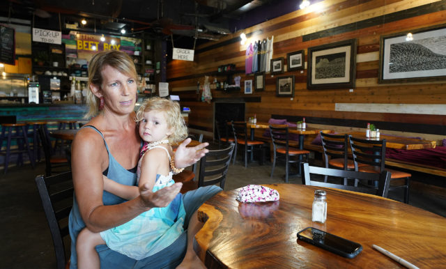 The Beet Box Cafe Haleiwa owner Marlys Mentz with her 4-year-old Moorea Mentz on her lap. Friday will be the first day of online and takeout orders. April 28, 2020.
