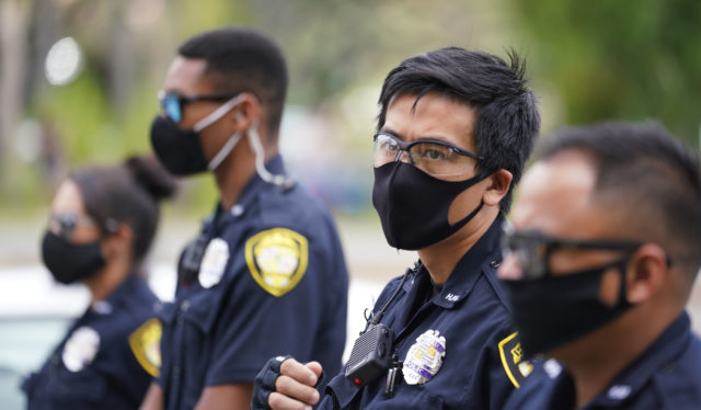 HPD Honolulu Police Dept officers at Re-Open Hawaii rally at the Capitol during Coronavirus COVID-19 pandemic. May 1, 2020