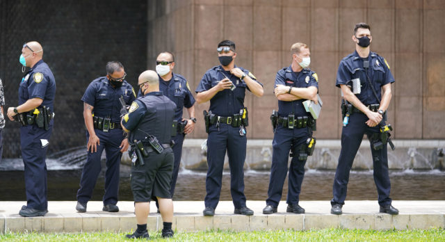 HPD Honolulu Police Dept officers not practicing 'social distancing' during a 'Re Open Hawaii rally at the Capitol during Coronavirus COVID-19 pandemic. May 1, 2020.