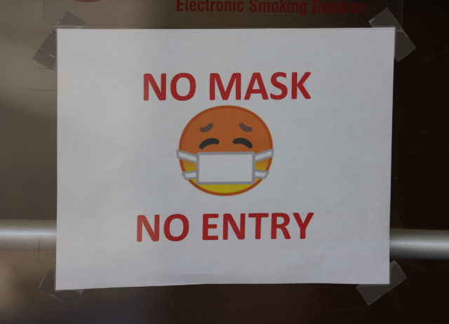 Department of Health building sign 'No Mask no entry' during Coronavirus pandemic. May 5, 2020
