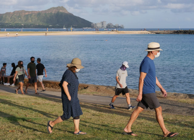 People get outside for fresh air and exercise with face masks at Magic Island in Honolulu, HI, Saturday, April 25, 2020. (Ronen Zilberman photo Civil Beat)