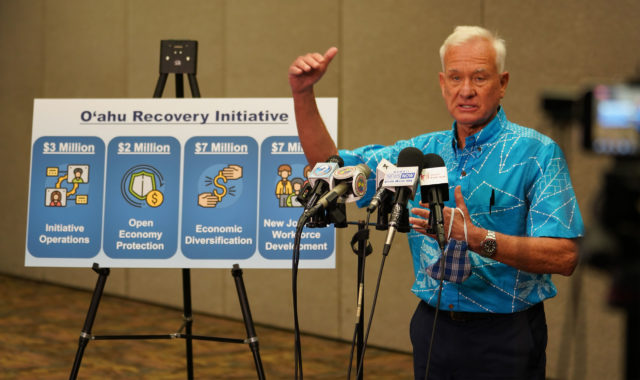 Mayor Kirk Caldwell gestures about the city of Honolulu's recovery coming out of the lock down. June 2, 2020