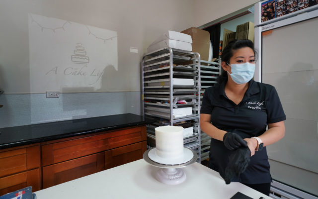 Kristin Kato preps a cake at her shop called A Cake Life located in the Moiliili area. Most wedding now during the pandemic have been smaller gatherings.