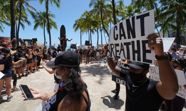 Black Lives matter Peaceful Protest supporters arrive at the Duke Kahanamoku Statue.