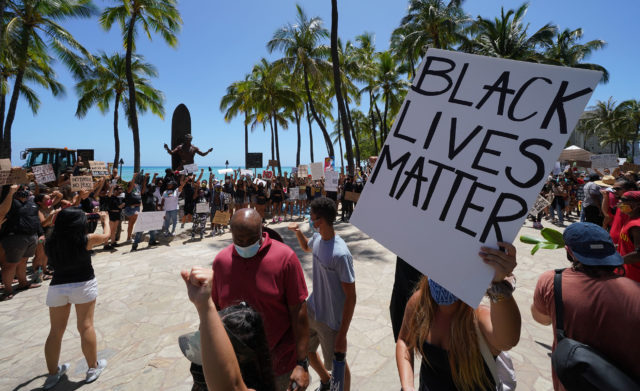 Black Lives matter Peaceful Protest supporters arrive at the Duke Kahanamoku statue after marching from Ala Moana Beach.