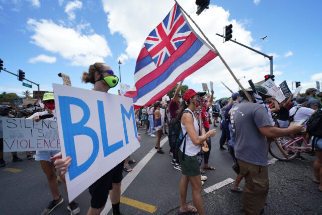 Black Lives Matter marchers leave Ala Moana Beach Park on their way to Ala Moana Beach Park.