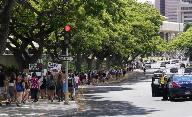 Black Lives Matter marchers walk towards the Capitol along Beretania Street after marching from Ala Moana Beach Park.