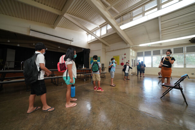 Kaneohe Elementary School summer school kids line up in the cafeteria socially distanced on their way to their classrooms. After arriving to the cafeteria, each child washed their hands and sat on socially disntanced chairs placed 6-feet apart. June 12, 2020