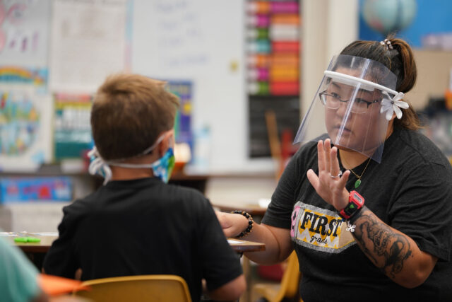 Kaneohe Elementary School summer school teacher Jolyn Yoneshige works on lesson with protective face shield on during COVID-19 pandemic. June 12, 2020