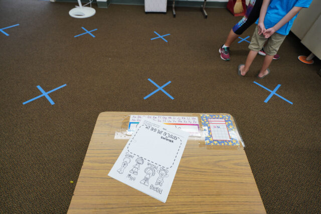 Blue tape marks social distancing inside a classroom at Kaneohe Elementary School summer school during COVID-19 pandemic. June 12, 2020