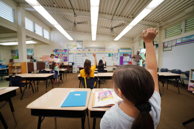 Kaneohe Elementary School summer school student raises her hand in class during COVID-19 pandemic. June 12, 2020