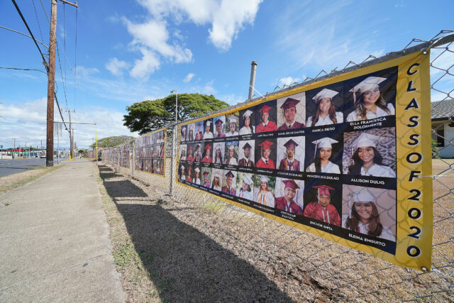 Farrington High School Class of 2020 graduation banners on the front of the school during COVID-19.