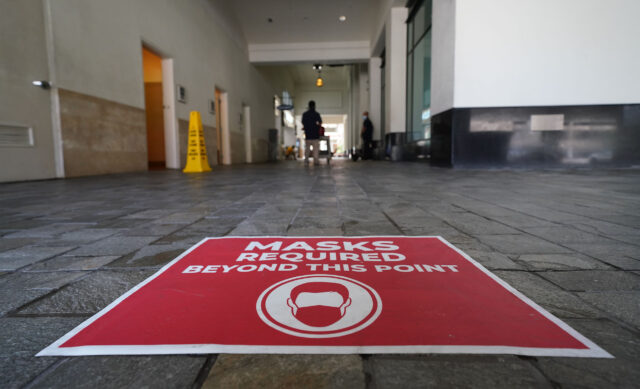 Ala Moana Center perimeter walkway with sign 'Masks Required beyond this point' during COVID-19 pandemic. June 24, 2020