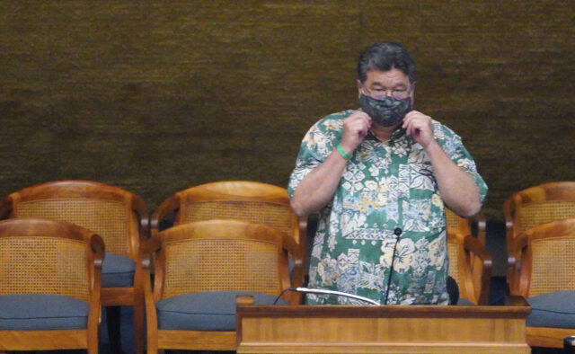 Senate President Ron Kouchi adjust his mask before the start of the floor session at the Captiol during COVID-19 era. June 26, 2020