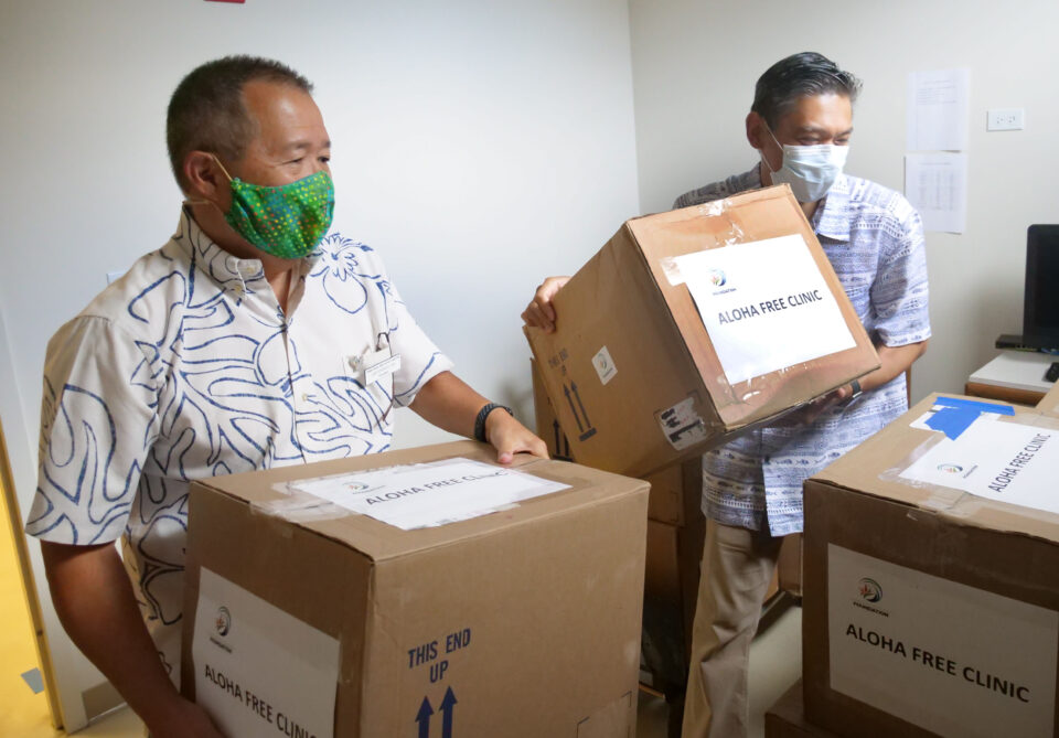 Gary Yonemoto, president of the Hawaii Dental Association Foundation and Dr. Jeffrey Sonson unload oral health kits for the for the Aloha Free Hawai'i Clinic on Thursday, July 2, 2020. The 2,500 kits provided by the Hawaii Dental Association Foundation include toothpaste, toothbrushes, floss, and educational materials. (Photo: Ronen Zilberman/Civil Beat)