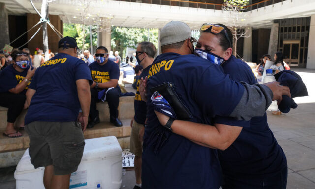 Right, Kathy Cruz hugs Don Faumunia during a SHOPO rally held at the Capitol Rotunda. July 6, 2020