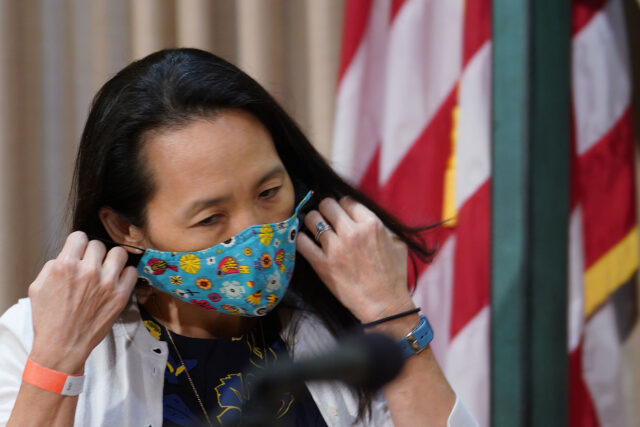 Department of Health Edpidemiologist Sarah Park removes mask before speaking during COVID-19 press conference announcing 41 new positive cases. July 7, 2020