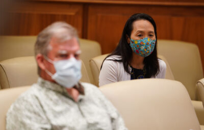 Department of Health Edpidemiologist Sarah Park sits socially distanced from DOH Director Dr. Bruce Anderson during COVID-19 press conference announcing a spike of 41 new cases. July 7, 2020