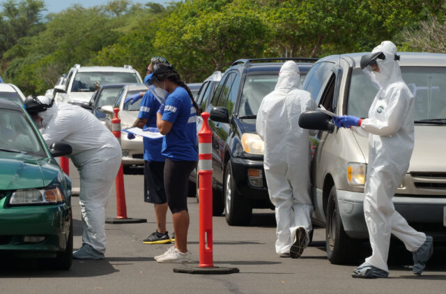 A team of medical technicians pre-screen residents who showed up for a COVID-19 drive-through testing event on Oahu, HI. (Ronen Zilberman photo Civil Beat)