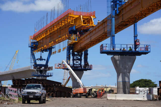 HART rail guideway columns leaving Airport industrial area as construction moves towards MIddle Street and town. July, 10, 2020