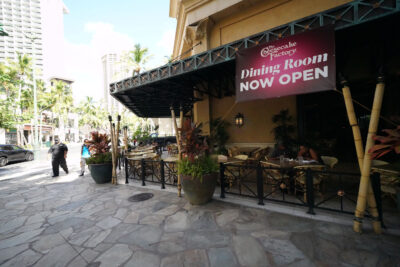 Cheesecake Factory located in Waikiki during COVID-19 pandemic. Sign reads, 'Dining Room Now Open' during pandemic. July 10, 2020