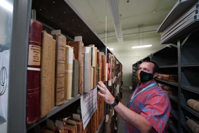 Hawaii State Archivist Adam Jansen show some of the older documents at the State Archives buiding, second floor.