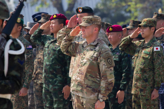 Col. John Lubas, commander of the 3rd Infantry Brigade Combat Team, 25th Infantry Division salutes while the U.S. and Royal Thailand National Anthems play, February 25, 2020, at Camp Akathotsarot in Phitsanulok Province, Thailand during the opening ceremony of Exercise Cobra Gold 2020. This is the 39th iteration of CG20, the largest joint-multinational military exercise in southeast Asia. The 10-day exercise is a series of training events that promotes and reinforces the enduring U.S./Thai alliance and demonstrates the U.S. military's unwavering commitment to a free and open Indo-Pacific.