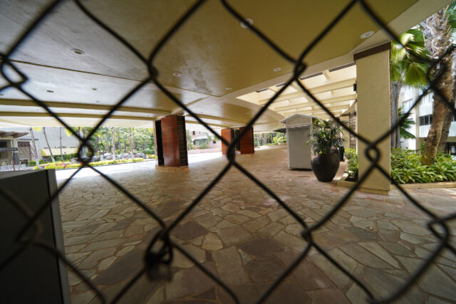 Sheraton Waikiki with view thru chainlink fence at the lobby area during COVID-19 pandemic. July 23, 2020