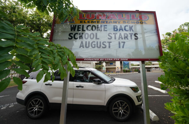 Lunalilo Elementary School sign on Fern Street, 'Welcome Back School Starts August 17' during COVID-19 pandemic. August 5, 2020