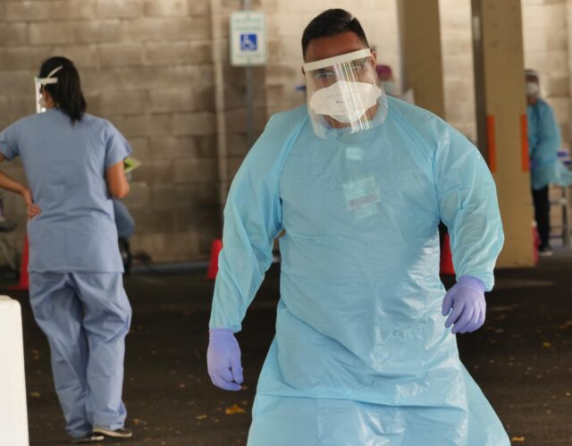 A COVID-19 testing technician by the Straub Medical Center in Honolulu, HI, on August 5, 2020. (Ronen Zilberman photo Civil Beat)